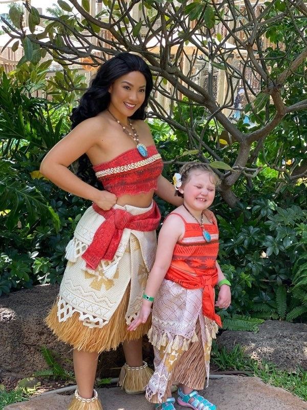 Young girl posing with Moana